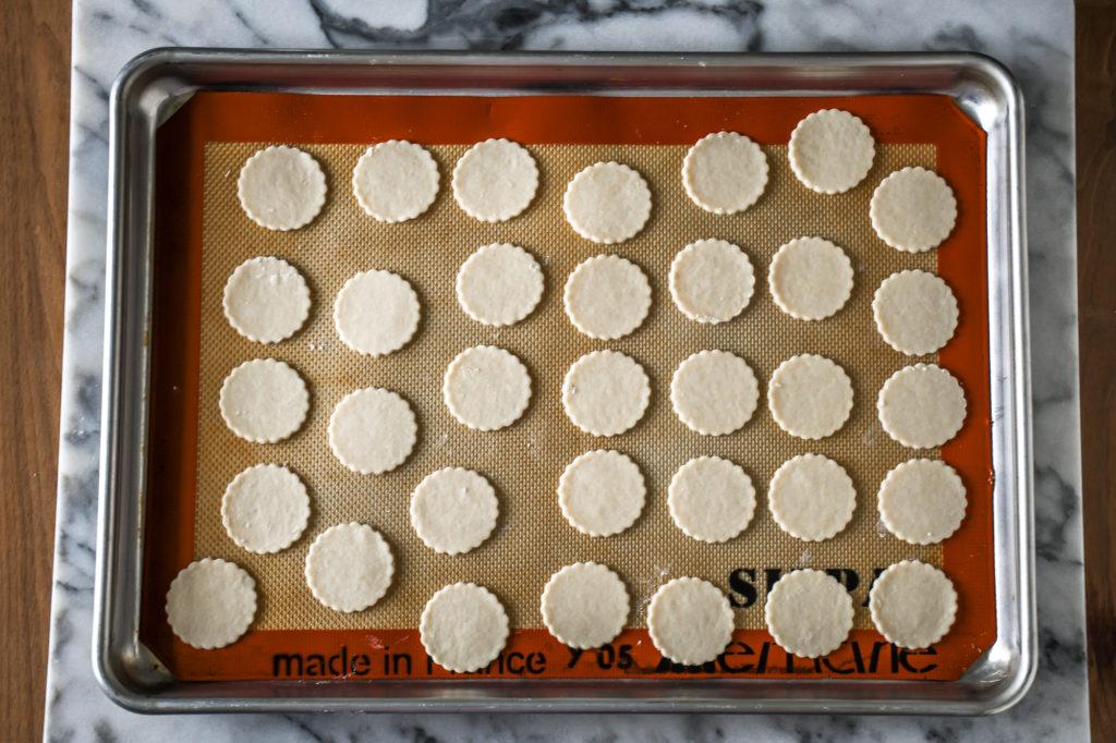 homeamde cracker dough arranged on a silpat lined baking sheet