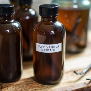 homemade vanilla extract in jars with labels