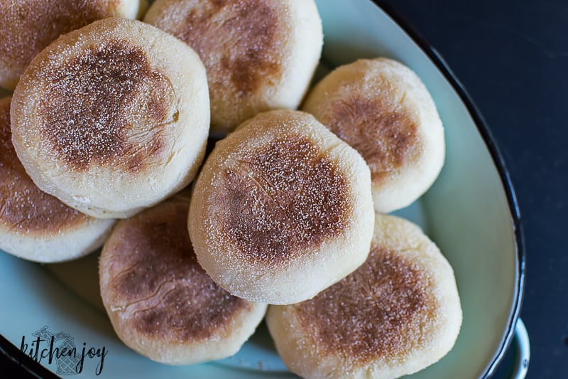 homemade sourdough English Muffins on tray