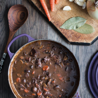Dutch oven filled with rich boeuf bourguignon